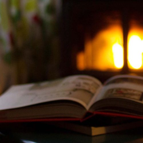 Reading and coffee near the fireplace