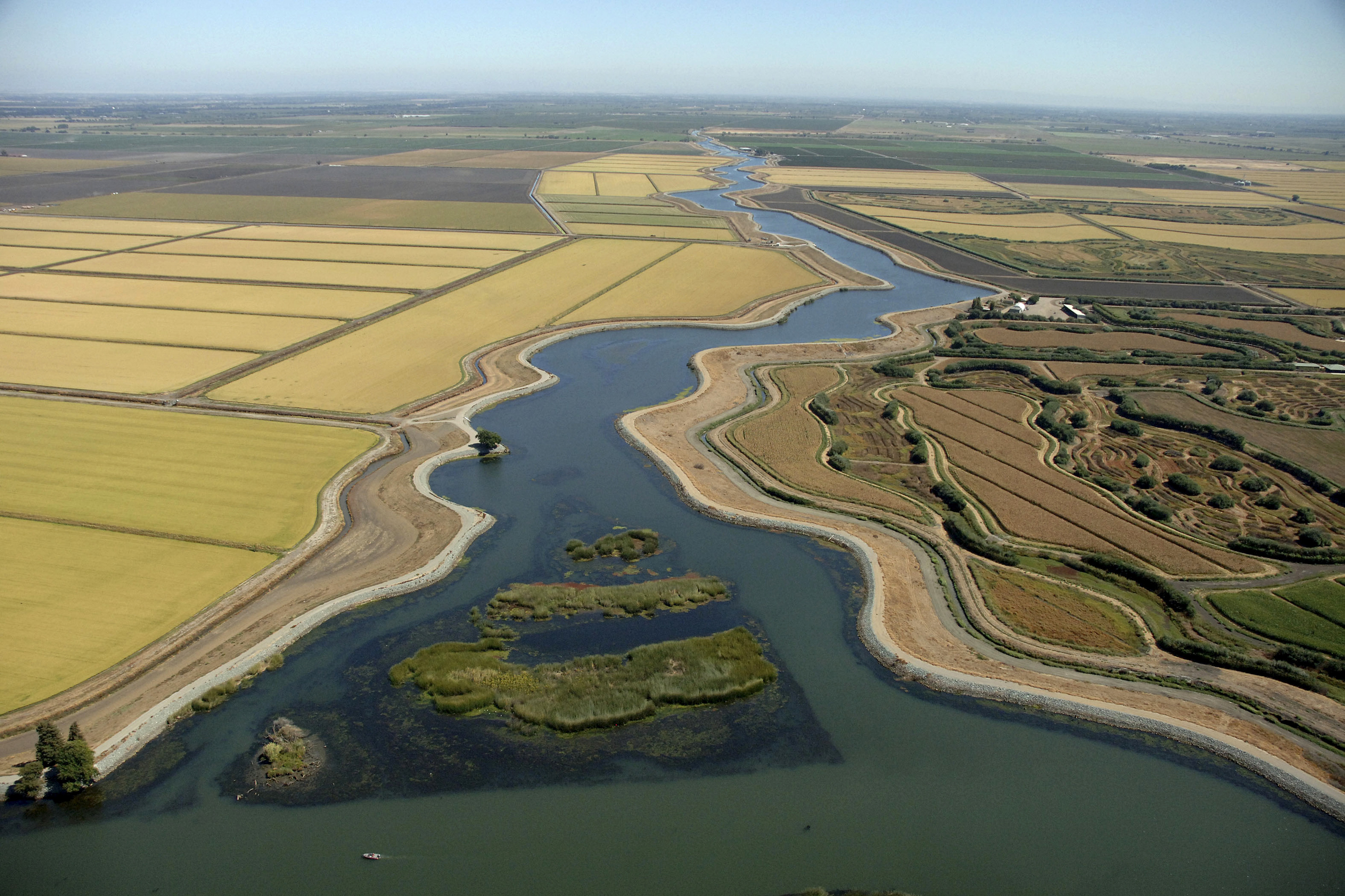 Aerial views of waterways & sloughs meandering through The Delta in California.
