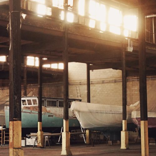 Boat being repaired in a warehouse