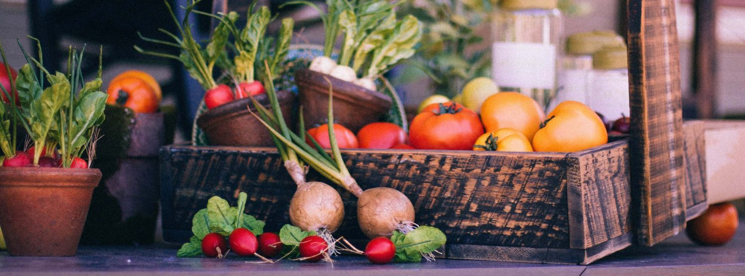 Veggies showcased in a basket of Delta's produce