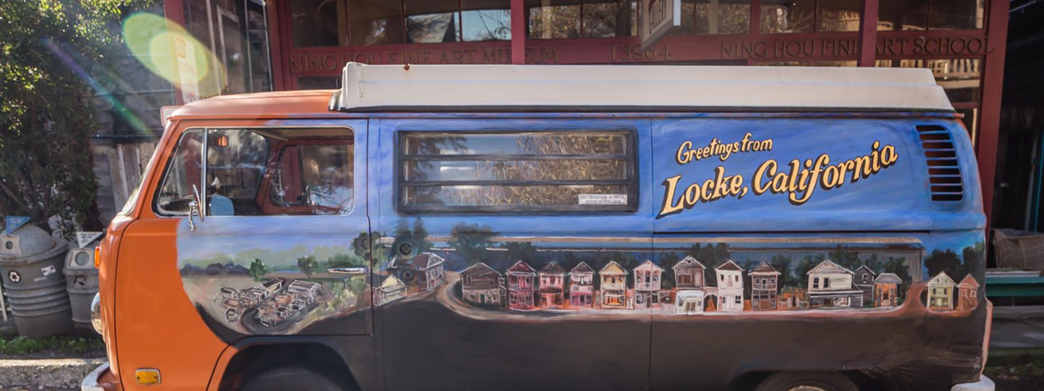 Painted van labeled with Greetings from Locke