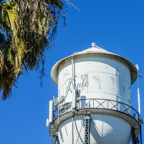 White Ryde Water Tower with Ryde labeled on it