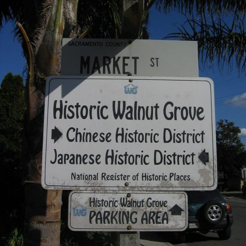 Market Street sign with Historic Walnut Grove directory sign underneath