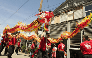 Dragon dancers holding up a dragon puppet to perform