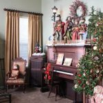 Holiday home decor with Christmas wreaths and a piano
