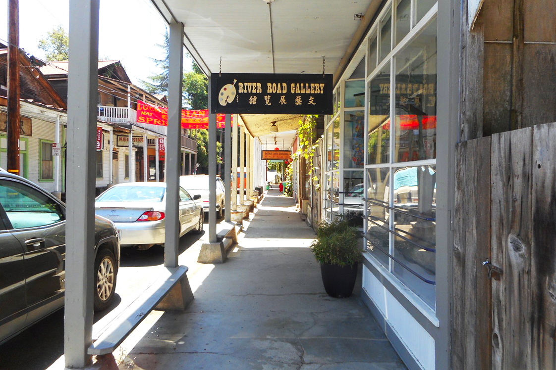 River Gold Gallery store sign in historic Locke