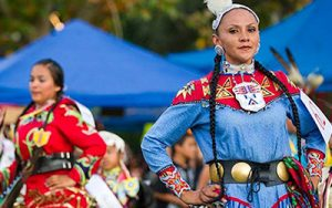 People celebrating Native American culture in cultural clothing