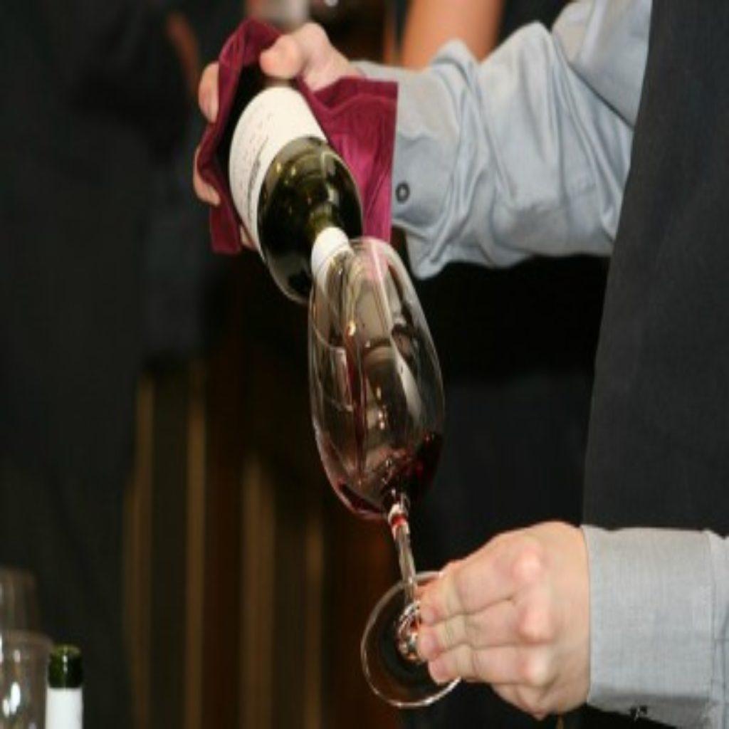 Man opening wine bottle