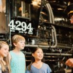 Train conductor talking to children